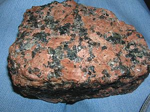 Alkali feldspar granite - Alkali feldspar granite. Holocrystalline texture, coarse-grained. Great amounts of potassium feldspar (orthoclase, pink-reddish in colour)
