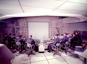 Semi-Automatic Ground Environment - Subsector Command Post of SAGE Combat Center at Syracuse Air Force Station with consoles and large display, which was projected from above. Archive photo taken during equipment installation.
