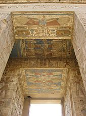 Stone doorway whose jambs and lintels are covered with images and hieroglyphs in relief. The reliefs are painted various colors.