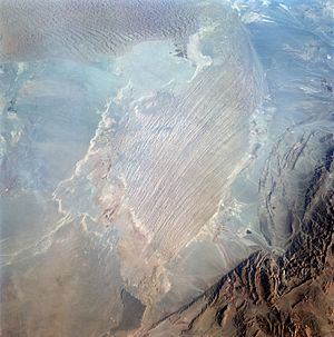Dasht-e Lut - This space image is centered on the Namak-Zar region of Dasht-E-Lut (Lut Desert) (30.5N, 58.5E) . The photo includes sand dunes and the Yardang type formations