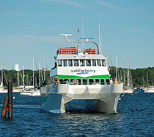 Multihull - The Salem Ferry Catamaran approaching its dock off Blaney Street in Salem, Massachusetts, United States