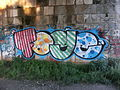 Sandstone wall with graffiti, Brno.JPG
