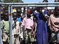 School children amazed by flowing water from pipe stand in Otho Abwao Kenya.jpg