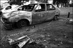 Remains of burnt car (Renault 19) during Frenc...
