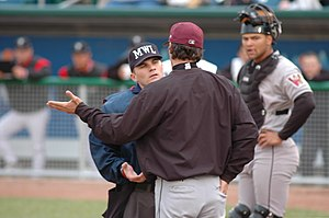 Ejection (sports) - Despite having been ejected, manager of the Wisconsin Timber Rattlers Scott Steinmann continues to argue with umpire Nicholas Nolde.