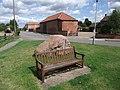 Seat and millennium stone on road through Shelford - geograph.org.uk - 936877.jpg