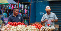 Seller offering tomatoes and onions to your customer.jpg