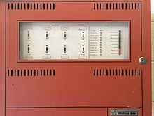 A Fire-Lite Sensiscan 1000 fire alarm control panel in a building at Oklahoma State University.