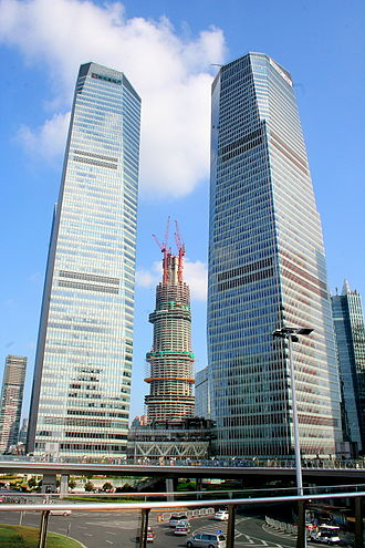 Shanghai IFC - Shanghai IFC in 2012 (with Shanghai Tower under construction in the background).