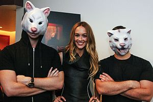 "Sharni Vinson - Sharni Vinson (center) with ""guardians"" at a 2013 showing of You're Next in Miami"
