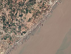 Ships anchored at Alang for scrapping, Satellite view, 17 March 2017