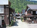 Street with two-storied wooden houses.