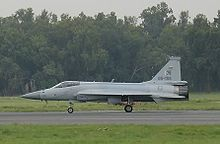 Side view of JF-17 taxiing with trucks in background cropped version.jpg