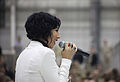 Singer and songwriter Bridget Kelly performs for U.S. Service members during the 2013 USO Chairman's Holiday Tour at Bagram Airfield, Parwan province, Afghanistan, Dec. 9, 2013 131209-A-HQ649-005.jpg