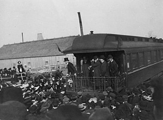 Exeter, Ontario - Sir Wilfrid Laurier speaking from the platform of a railway observation car in Exeter during the federal election campaign, November 1904.