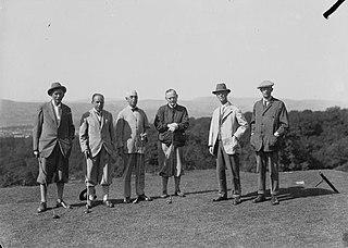 Six gentlemen golfers on a golf course