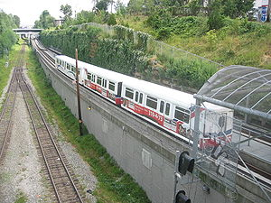 History of the SkyTrain - A MK I train passing by on the Millennium Line, between VCC–Clark Station and Commercial–Broadway Station.
