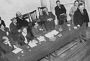 Ilie Moscovici - Moscovici (back row, in dark suit), listening in as Paul Löbe speaks in front of the Socialist Inter-Parliamentary Conference of 1931. The photograph also shows Constantin Titel Petrescu (seated directly in front of Moscovici), Lothar Rădăceanu, Yanko Sakazov, and various representatives of the Belgian and Czechoslovak socialist parties