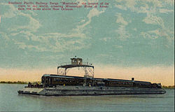 Postcard photo of the Southern Pacific railroad barge Mastodon crossing the Mississippi River at Avondale, Louisiana. The railroad also had railroad ferries which worked in the San Francisco area for the same purpose.