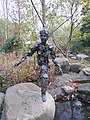 Statue of a child made of vines in the Memphis Botanic Garden.jpg