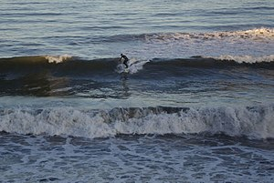 English: Surfing at Aberdeen A lone surfer mak...