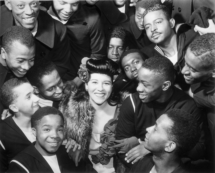 File:Surrounded by recruits, Marva Louis, wife of champion Joe (Louis), takes time out from a tour of nightclubs... - NARA - 535855.tif