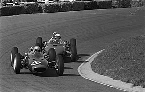Lola Mk4 - Surtees leads defending World Champion Phil Hill's Ferrari, on the Mk4's Championship debut at the 1962 Dutch Grand Prix
