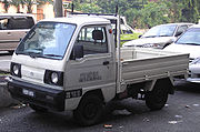 The pickup variant of the fifth generation Suzuki Carry is an example of a kei car-classed cab-forward pickup truck.