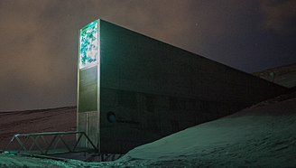 Svalbard Global Seed Vault - Entrance to the Seed Vault at dusk, highlighting its illuminated artwork