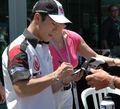 Takuma Sato signing.jpg