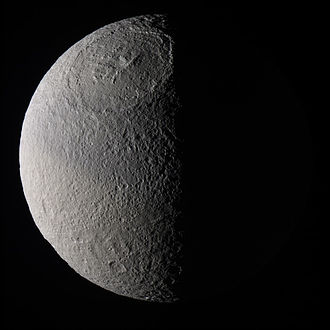 Tethys (moon) - Huge, shallow crater Odysseus, with its uplifted central complex, the Scheria Montes, is at the top of this image.