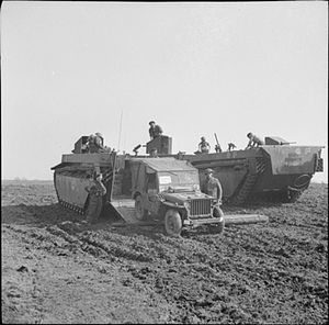 31st Armoured Brigade - A Buffalo of 4th Royal Tank Regiment unloads a jeep during the crossing of the Rhine, 24 March 1945