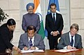 The Chairman ISROAntrix & Secretary Dept. of Space, Dr.G. Madhavan Nair and the Foreign Minister of France, Mr. Bernard Kouchner signing agreement on peaceful use of space, in the presence of the Prime Minister.jpg