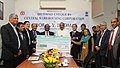 The Minister of State (Independent Charge) for Consumer Affairs, Food and Public Distribution, Professor K.V. Thomas receiving a dividend cheque from the Chairman, Central Warehousing Corporation, Dr. C.V. Ananda Bose.jpg