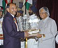 The President Dr. A.P.J. Abdul Kalam presenting the Dronacharya Award -2005 to Shri Maha Singh Rao for Wrestling, at a glittering function in New Delhi on August 29, 2006.jpg