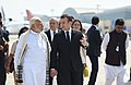 The Prime Minister, Shri Narendra Modi receiving the President of the French Republic, Mr. Emmanuel Macron, on his arrival, at Varanasi, Uttar Pradesh on March 12, 2018 (2).jpg