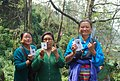 The women voters showing the mark of indelible ink after casting their vote, at a polling booth during the 4th Phase of Lok Sabha General Elections-2014, in Sikkim on April 12, 2014.jpg