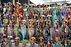 Palm Sunday Handcraft Market - La Calavera Catrina figures from Capula at the market