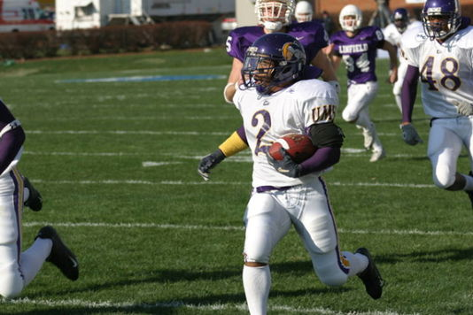 Tim Walker charges towards the end zone on a punt return against Linfield in the NCAA Div III Championship Game Tim Walker UMHB.jpg