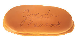 Tony Packo's Cafe - A souvenir hotdog bun from Tony Packo's Cafe signed by the photographer.