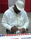 Too Tall Jones signs autographs in Jan 2014.jpg