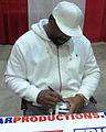 Too Tall Jones signs autographs in Jan 2014.jpg