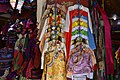Traditional Tibetan clothes for sale in a Lhasa market.jpg