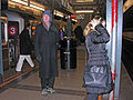 Travelers at Wall Street subway Station, New York.jpg