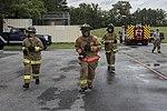 Trevette Kuester, Joint Base Andrews Fire Explorer Academy cadet, performs a hose pull.jpg