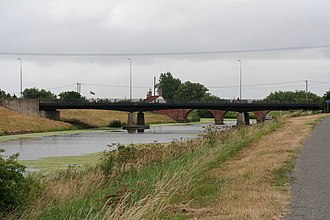 A153 road - The A153 crosses the River Witham at Tattershall bridge. The 1969 bridge in the foreground, the older brick one behind