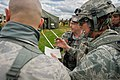 U.S. Air Force Lt. Col. Bonnie Stiffler, front right, a clinical nurse with the 81st Medical Group, Keesler Air Force Base, Miss., describes a tent layout plan with observer-controller-trainers during Joint 140314-F-XL333-176.jpg