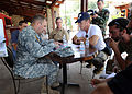 U.S. Army Gen. P.K. Keen, commanding general of Joint Task Force Haiti, talks with actor Sean Penn March 15, 2010, in Port-au-Prince, Haiti 100315-N-HX866-008.jpg