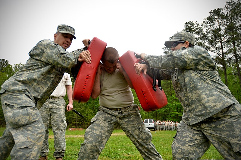 File:U.S. Army Pfc. Christopher Arrowood, center, with Headquarters and Headquarters Company, 105th Military Police Battalion, North Carolina Army National Guard, makes his way through a defense course during 130501-Z-AY498-010.jpg