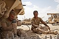 U.S. Marine Corps Sgt. Christopher Cannella, left, and Cpl. Wilmer Rivas, tank mechanics assigned to Delta Company, 1st Tank Battalion, prepare a tank track while conducting maintenance on an M88A2 Hercules 130507-M-YH552-110.jpg